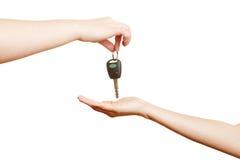 Hand offering car keys. Car dealer offering car keys to a hand Stock Photos