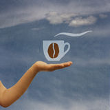 On hand offering coffee Stock Photo
