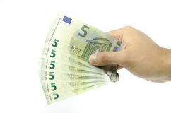 Hand offering five euro banknotes Royalty Free Stock Photos