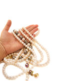 Hand offering jewel Royalty Free Stock Images