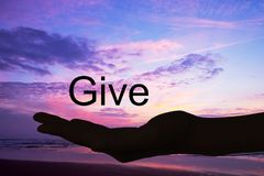 Hand offering the word give,sunset background. Hand offering the word give, sunset background Stock Image