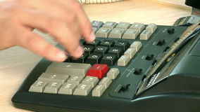 Hand in office calculating machine stock video footage