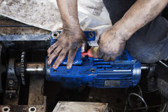 Hand oiling gear and during maintenance work of electric motor. Hand of repairman oiling gear and during maintenance work of electric motor stock photography
