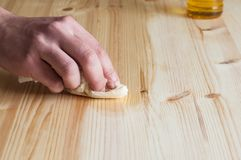 Restoring an wood furniture. Hand oiling a wood surface Royalty Free Stock Photo