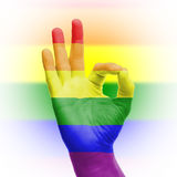 Hand OK sign with rainbow flag Stock Photography