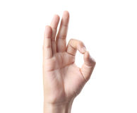 Hand in ok sign. On a white isolated background Royalty Free Stock Image