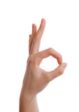 Hand in ok sign on a white isolated background Stock Photo