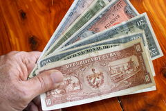 Hand and old cuban money Royalty Free Stock Photo
