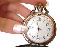 Hand with old golden pocket watch Royalty Free Stock Images