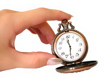 Hand with old golden pocket watch Stock Photo