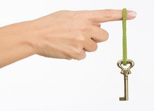 Hand with old key Stock Image