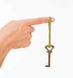 Hand with old key Royalty Free Stock Image
