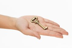 Hand with old key Stock Photography
