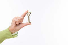 Hand with old key Royalty Free Stock Images