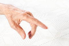 The hand of the old man points to something. Closeup Royalty Free Stock Photo
