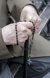 Hand of old man by prayer. Of rosary Royalty Free Stock Photo