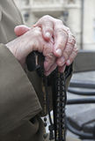 Hand of old man by prayer. Rosary Stock Photos