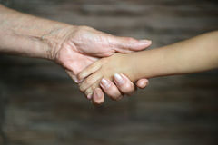 Hand of old people and a baby hand Royalty Free Stock Images