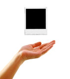 Hand with old photo frame isolated Stock Photos