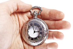 Hand with old pocket watch Royalty Free Stock Photos