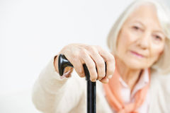 Hand of old senior woman on cane Stock Image