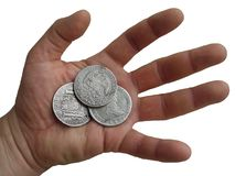 Hand with old silver coins. Stock Image