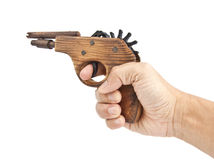 Hand with an old toy gun Stock Photo