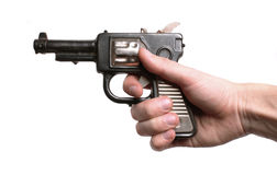 Hand with an old toy-gun Royalty Free Stock Image