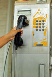 Hand  and old vintage phone booth. Stock Image