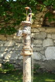 Hand old water pump - retro style Royalty Free Stock Image