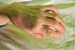 Hand of old woman on the bed Royalty Free Stock Images
