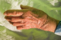 Hand of old woman on the bed Stock Photos