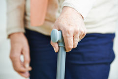 Hand of old woman on cane Royalty Free Stock Photography