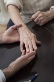 The hand of an old woman on a dark background. The hand of an old women on a dark background. Medical examination. The doctor holds the old woman`s hand Stock Photography