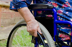 Hand of the old woman on an invalid armchair Stock Photo