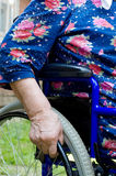 Hand of the old woman on an invalid armchair Stock Image