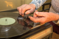 Hand of old woman with the old gramophone Stock Photography