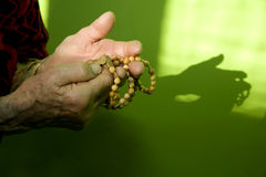 Hand of old woman by the prayer. In morning Royalty Free Stock Image