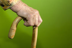 Hand of old woman with the stick Stock Photography