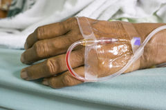 Hand of a old women patient with saline intravenous (IV) in Stock Photos