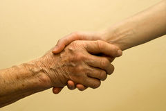 Hand of old and young woman Royalty Free Stock Photo