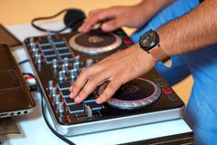 Hand one DJ stirring in your pick up Royalty Free Stock Photos
