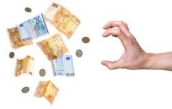 Hand ongeveer om geld te grijpen Stock Foto