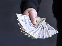Hand op contant geld financiën corruptie Onwettige transacties royalty-vrije stock afbeeldingen