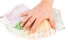 Hand op geld stock foto