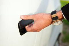 Hand opeing car door Royalty Free Stock Image