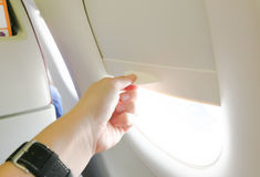 Hand Open the airplane window Royalty Free Stock Image