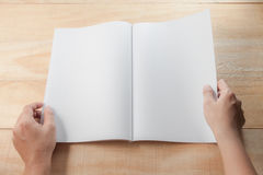 Hand open blank book or magazines Royalty Free Stock Photography