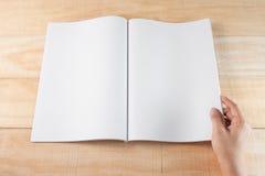 Hand open blank book or magazines Stock Photos