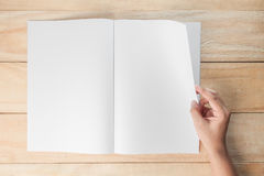 Hand open blank book or magazines Stock Image